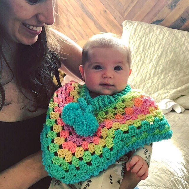 omigod y'all look at the poncho my mom's friend made for stevie girl
