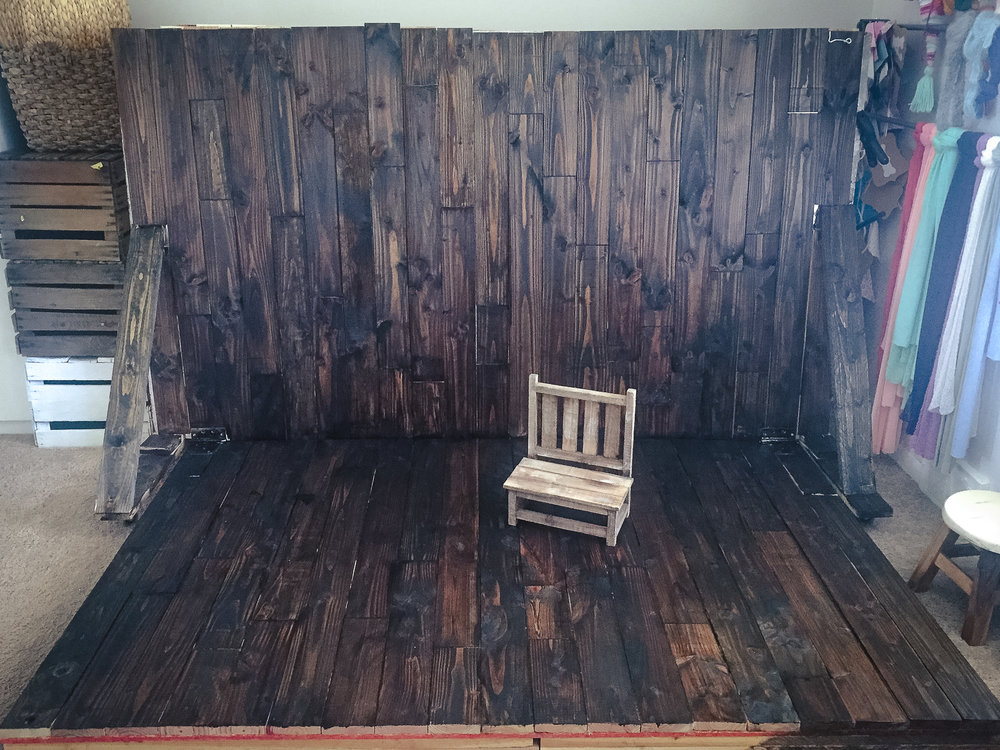 Quick cell picture of the wood side in the room. The white side is flipped up, secured with a hook, and pushed against the wall.