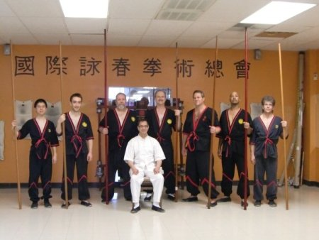 Here is a photo from the long pole seminar with my camera where everyone is balanced evenly around Mr. Leung.  Please note that of the 7 instructors standing, 4 of them have left the IWTA voluntarily.