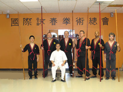 Doh! Does this photo seem a bit lopsided to you?  Look at the missing wall-bags and also look at the floating long pole tip on the upper left ceiling.  Turns out Santa Claus is a only slightly better at photoshopping than he is at Wing Tsun.