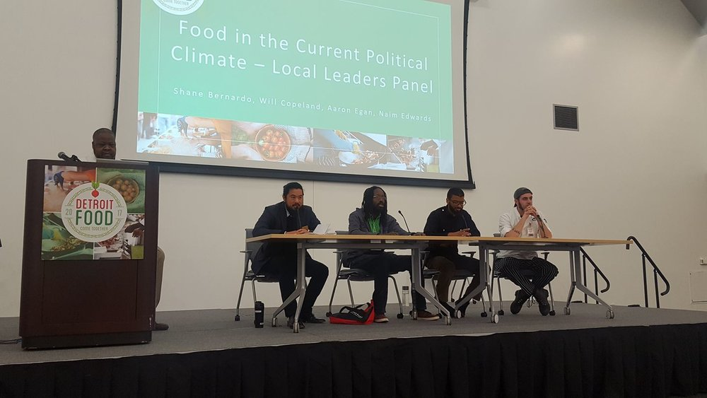 William (middle) speaking on a food justice panel.