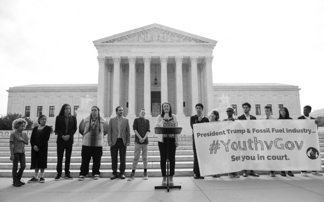 Jacob (fifth from left) with other #youthvgov plaintiffs at the Supreme Court. (Photo: Robin Loznak)