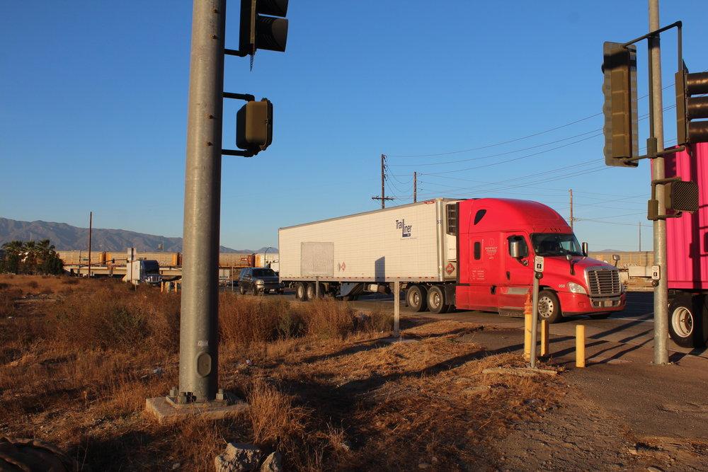 Trucks on a street near Dania's school.