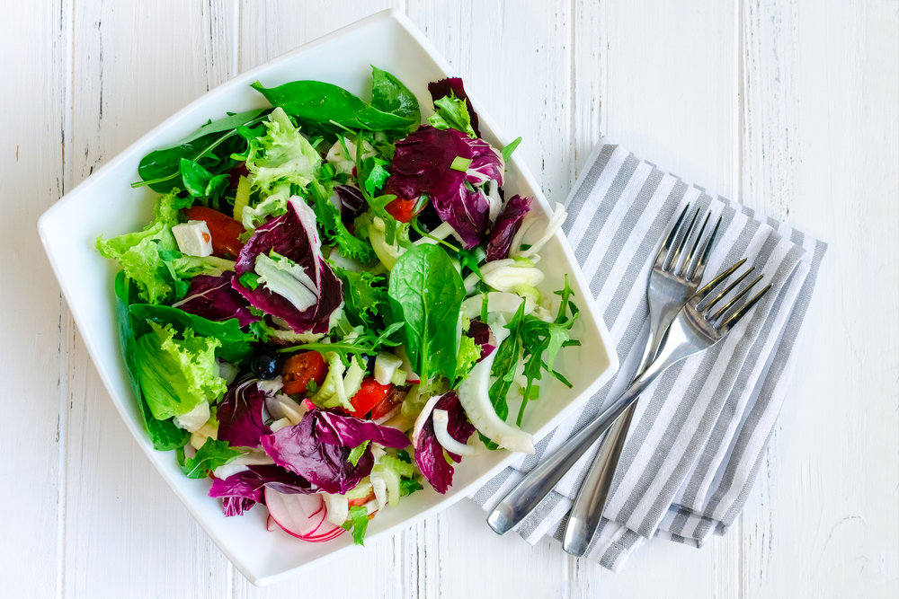 Fresh-summer-green-salad-mix-on-a-wooden-table-859364404_2528x1686.jpeg