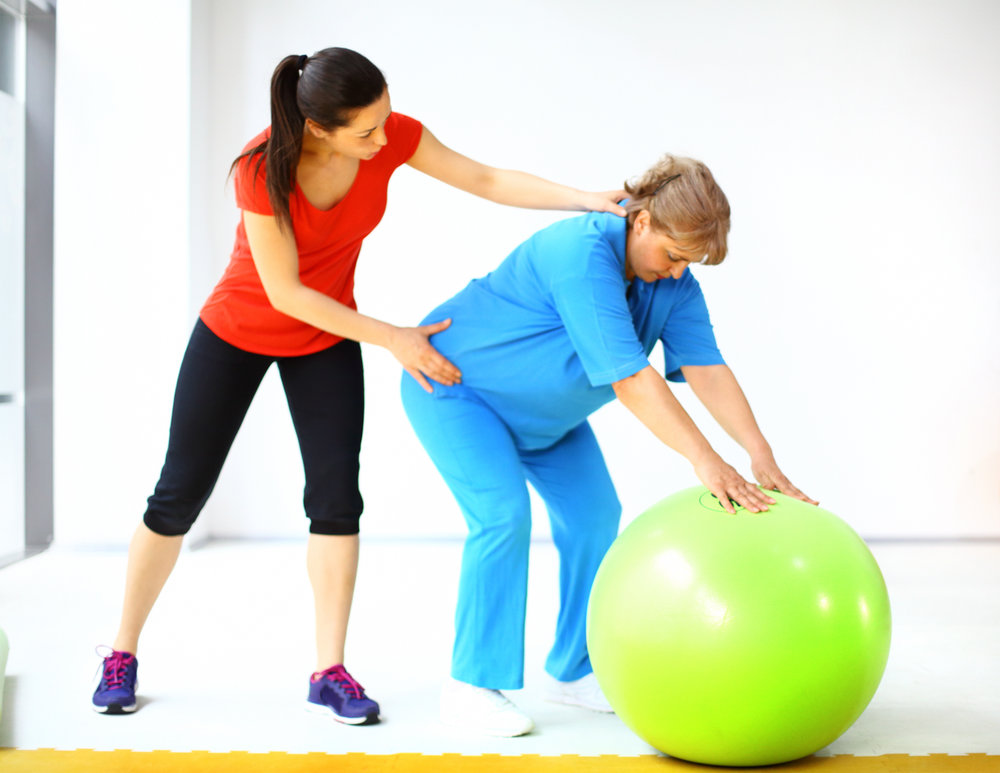 instructor with women and green ball.jpg
