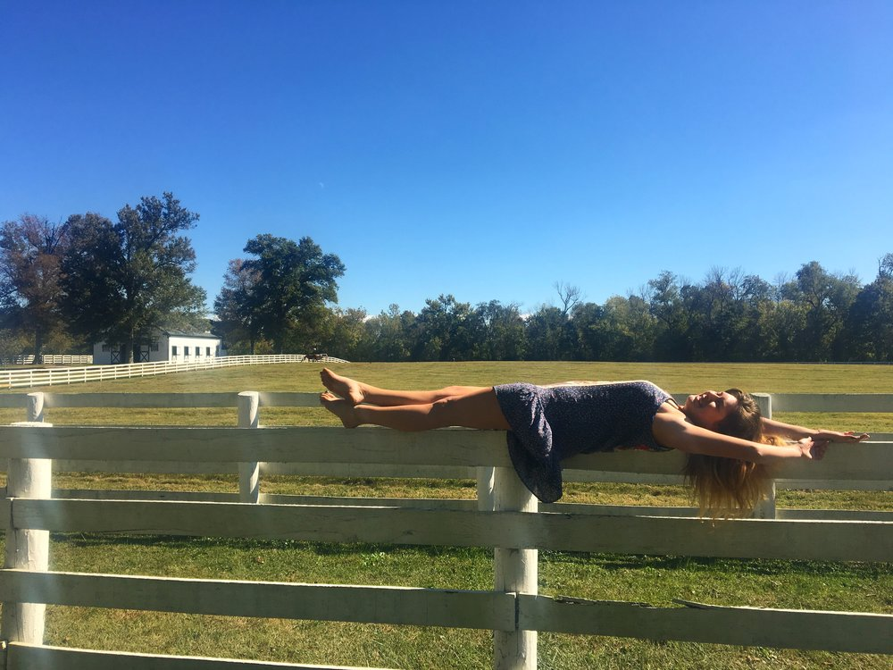 Lol we were doing this photoshoot, getting off the fence out of this pose was difficult, especially because I was laughing, so I just fell off the fence. The easiest way was a body roll straight to the ground.