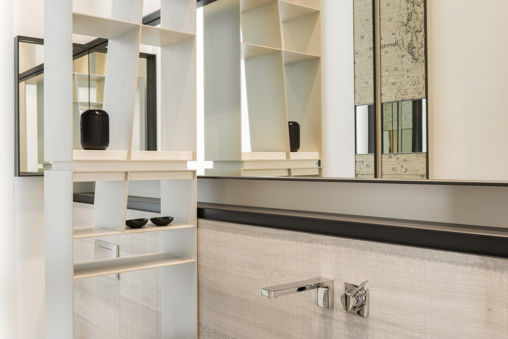 Custom built shelving by Genesis Interiors are found in the powder room...