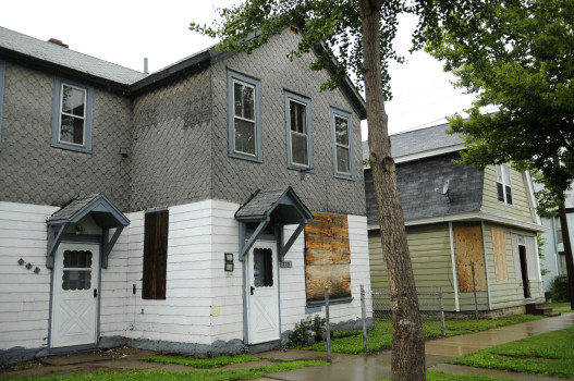 In 2009, 275 Bates Ave., foreground, in the Dayton's Bluff neighborhood of St. Paul, could be purchased for $1 from the St. Paul Housing and Redevelopment Authority. 279 Bates, next door at right, was on the market for $5,000. Since then, 279 Bates has been rehabbed and is now on the market for $169,900. (Pioneer Press file photo: Scott Takushi)