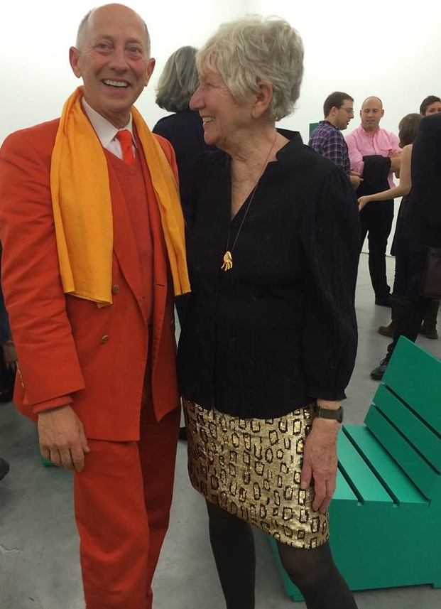 Mary Heilmann wearing leopard print sequin skirt at her show at 303 Gallery, with Knight Landesman wearing a suit of his own design