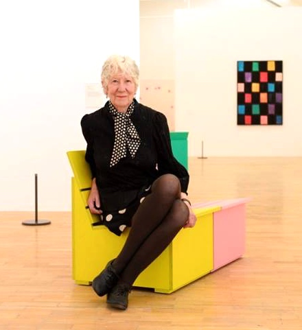 Mary Heilmann wearing silk polka-dot skirt and silk polka-dot scarf at her show at Whitechapel Gallery, London