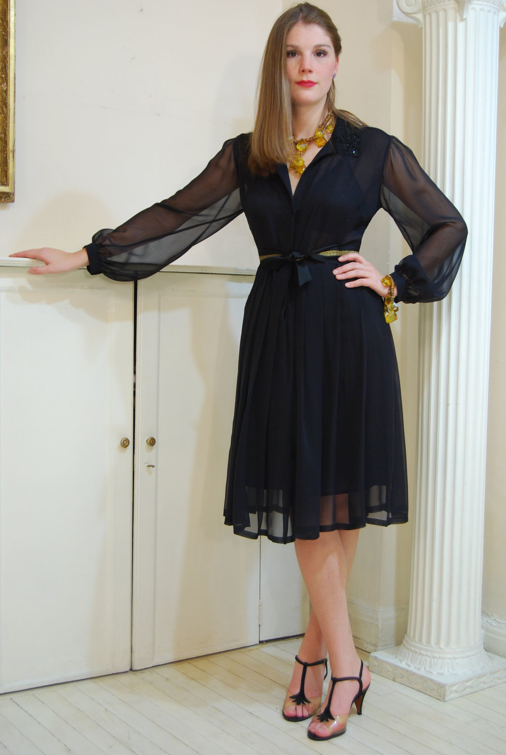 Black silk chiffon /lycra with caviar beaded collar and ribbon belt.  covered snap front closure