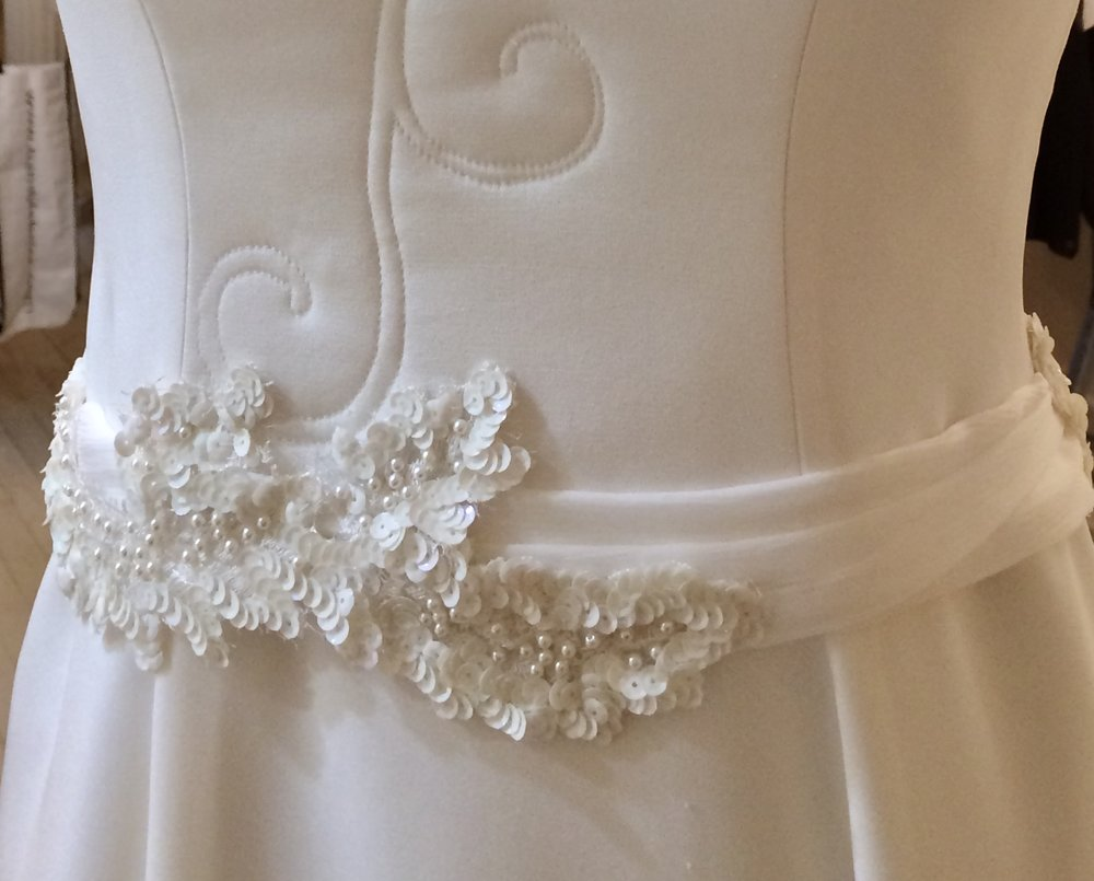 detail of French Lace (sequined beadwork) on wedding dress