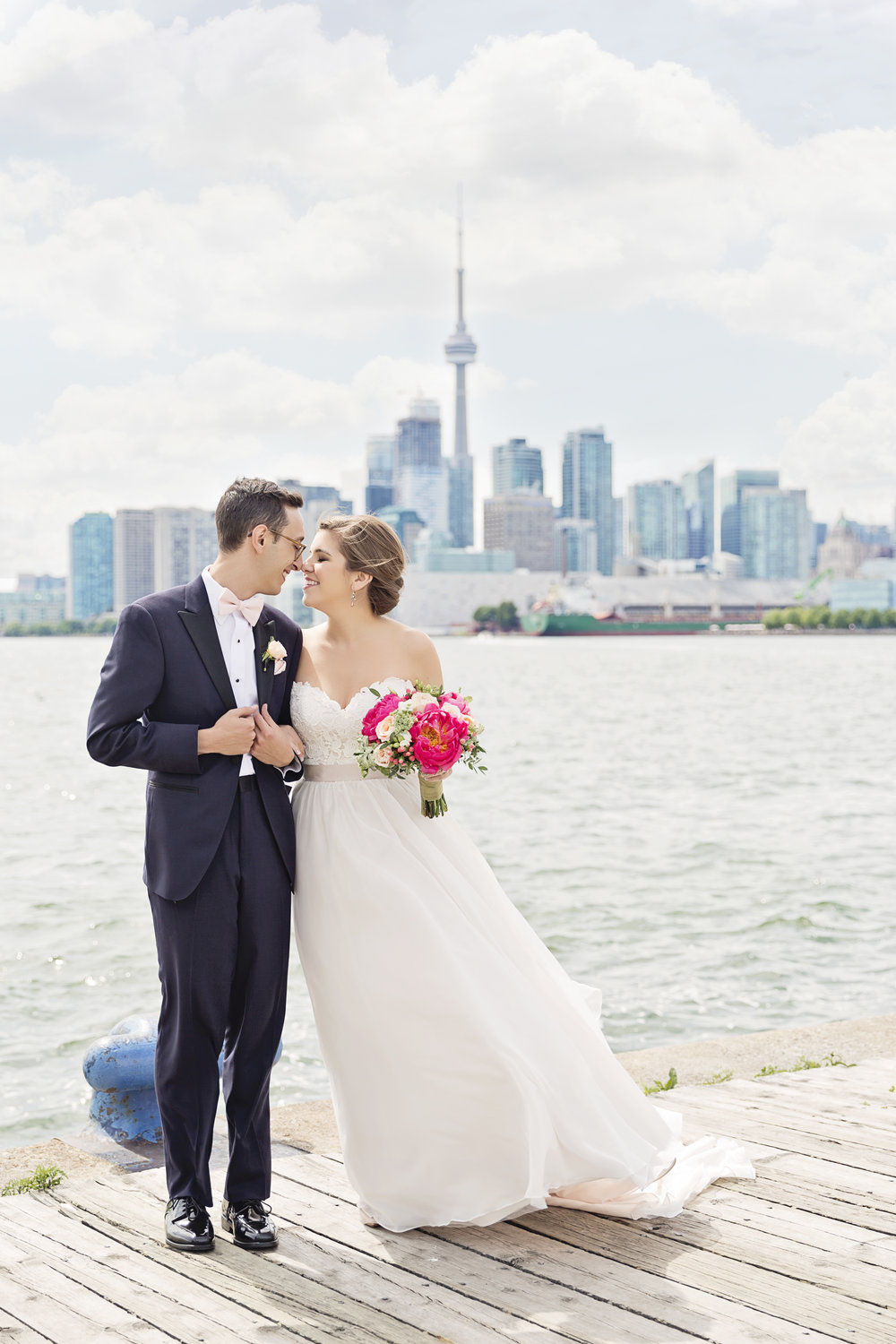 """I would definitely recommend Jasmine to any couple who wants a beautiful wedding day that they, their families and friends can enjoy stress free. She went above and beyond our expectations. She made our family and bridal party feel taken care and heard, helped other vendors solve their issues, through every detail, and added lots of extra little touches.""       Meghan & Adam Toronto, ON"