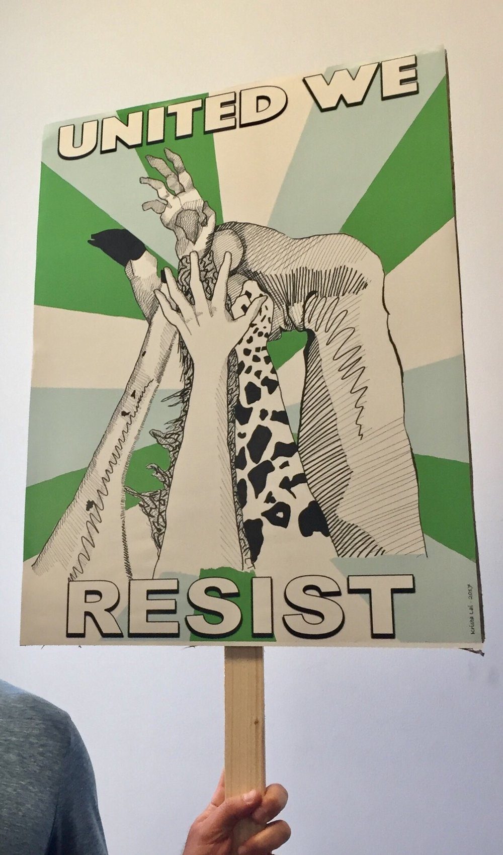 """""""United We Resist"""" protest sign after editing, scanning and printing on signage material. By Krista Dedrick Lai and Ernie Migali"""