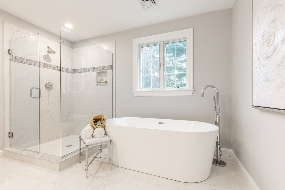 Simple yet elegant staging really helped complete the 'luxury' look for this bathroom in a Lexington colonial.
