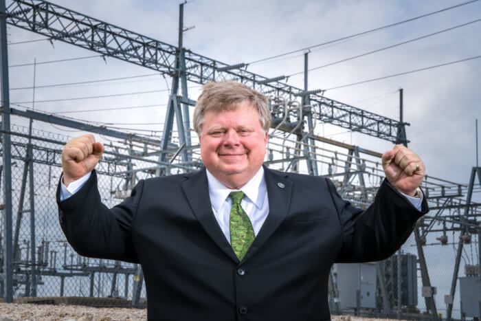 Georgetown-Mayor-Dale-Ross-in-front-of-power-plant.jpg