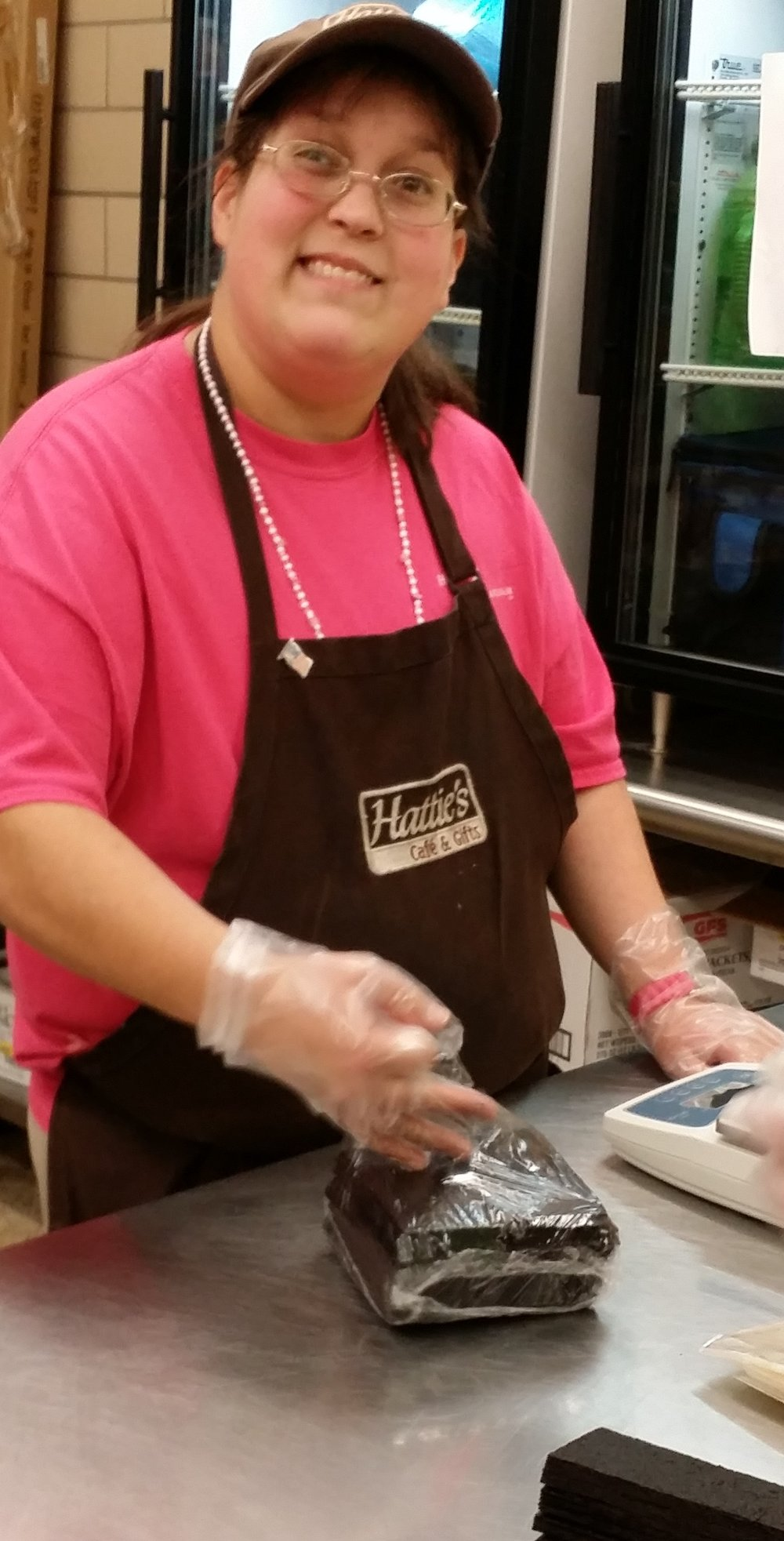 Here's a picture of Briana, from Hattie Larhlam, finishing a batch of cut fruit snacks!