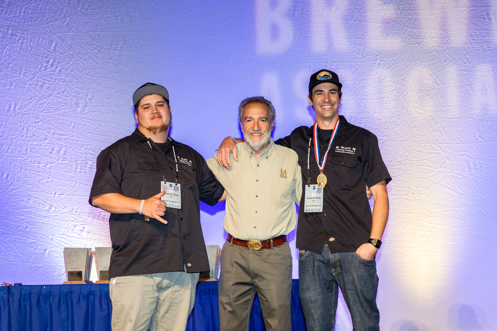 Sales Manager Javier Morales, founder of the Association of Brewers Charlie Papazian, and Head Brewer Ryan Morrill in GABF glory.