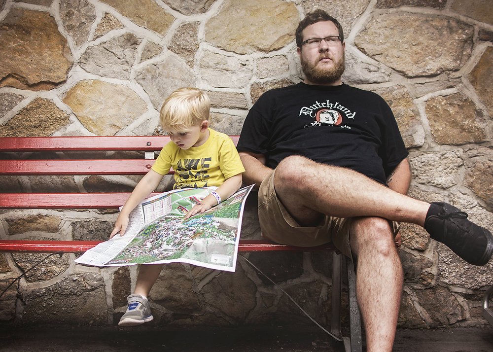 This kid loves his maps. He couldn't wait to find all the rides he NEEDED to ride while everyone else took a potty break.