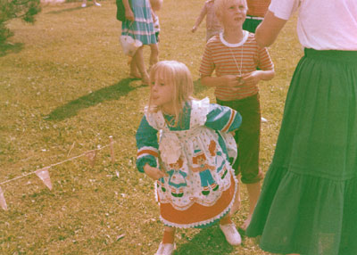 This about sums it up. Sticking my tongue out, in a pretty dress that my mom sewed herself.
