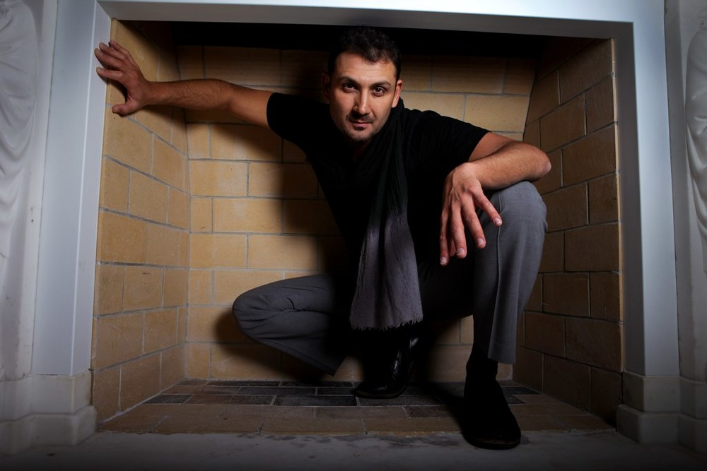 Founding Artistic Director, John Farmanesh-Bocca, in a Fireplace