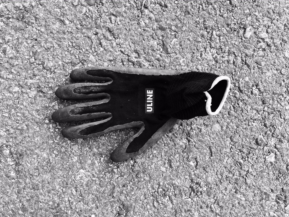 The ubiquitous safety glove, surprisingly new, found on the side of a busy feeder road.