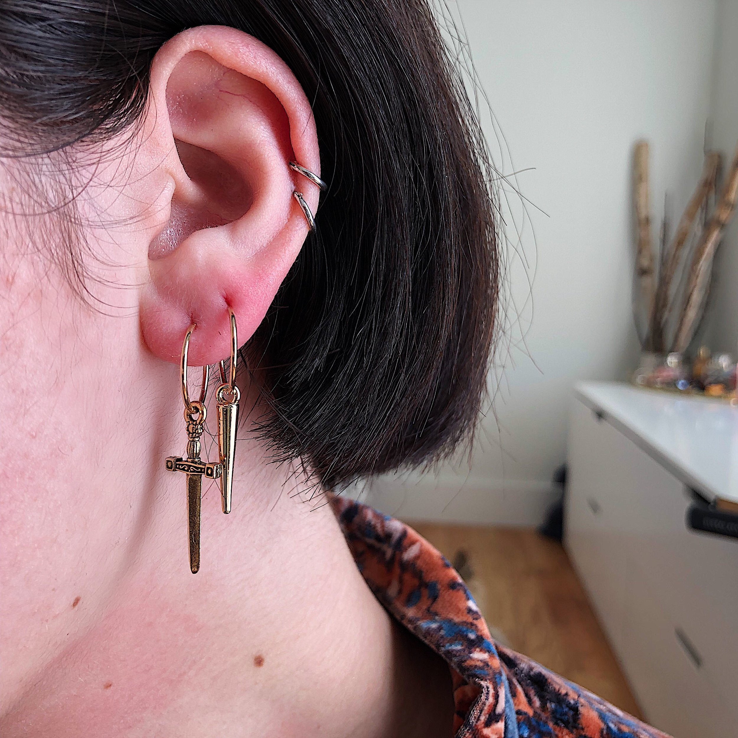 a89d63b39 The Drop Dagger Hoops in Gold DALMATA