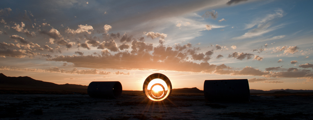 "Nancy Holt ""Sun Tunnels"" (1973-1976) Location: Utah Desert. The artist installed 4 concrete pipes forming a cross. Every Winter and Summer Solstice, the sun beam lights the interior of the pipes, perfored with holes corresponding to constellations of:"
