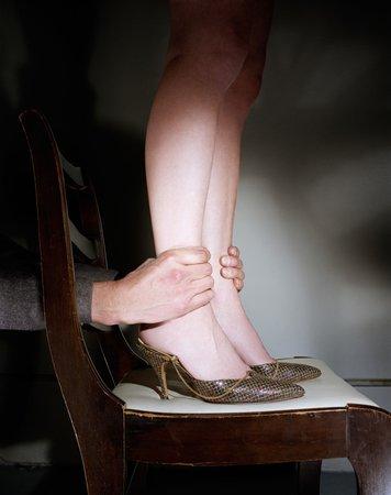 Jo Ann Callis, Hands Grabbing Ankles, 1976 Courtesy of ROSEGALLERY, Santa Monica