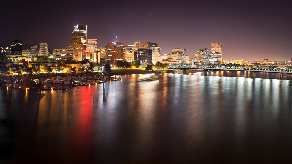 The view of Portland, OR, as seen from the I-5 Bridge. Notice the Portland Spirit in the center of the photograph.