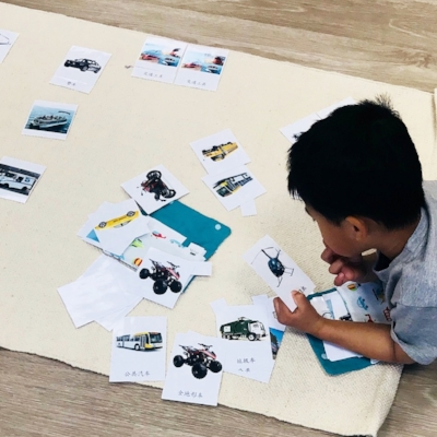 A child is working with language cards.