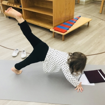 A child is practicing yoga.
