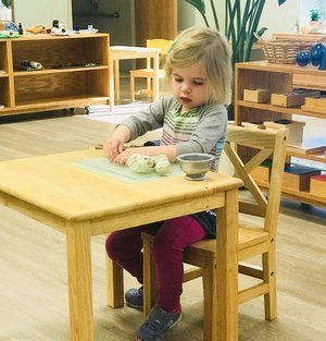 Child Working With Clay
