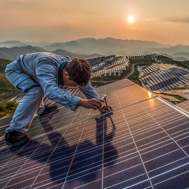 This stunning photograph shows a worker at Xinyi photovoltaic power station in Songxi, China.  China will lead the world for growth in renewable power, the IEA has predicted.  Photograph: Feature China / Barcroft Images  #solarpower #renewableenergy #sustainability #ecofriendly #china #greenenergy