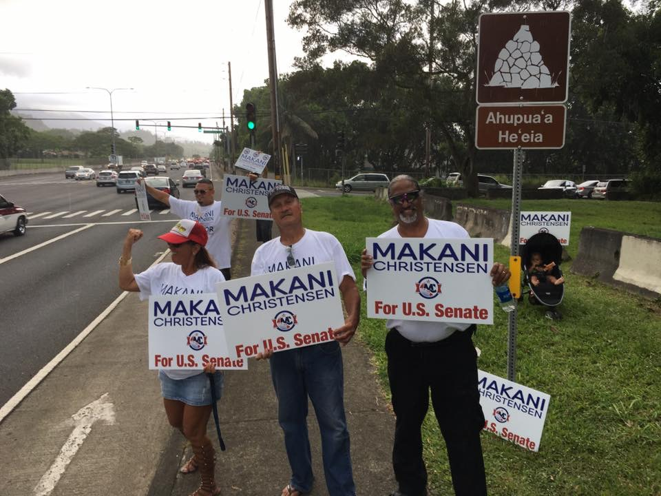 sign waving keoni.JPG