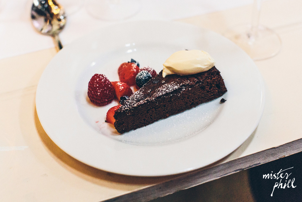 Chocolate torte with crème fraiche and summer berries