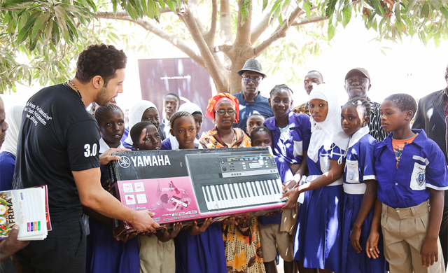 AFRIMA AWARDS winner, Ahmed Soultan of Morocco presenting musical equipment to Bakotech Proper Lower Basic School in Banjul, Gambia on May 25th, 2016