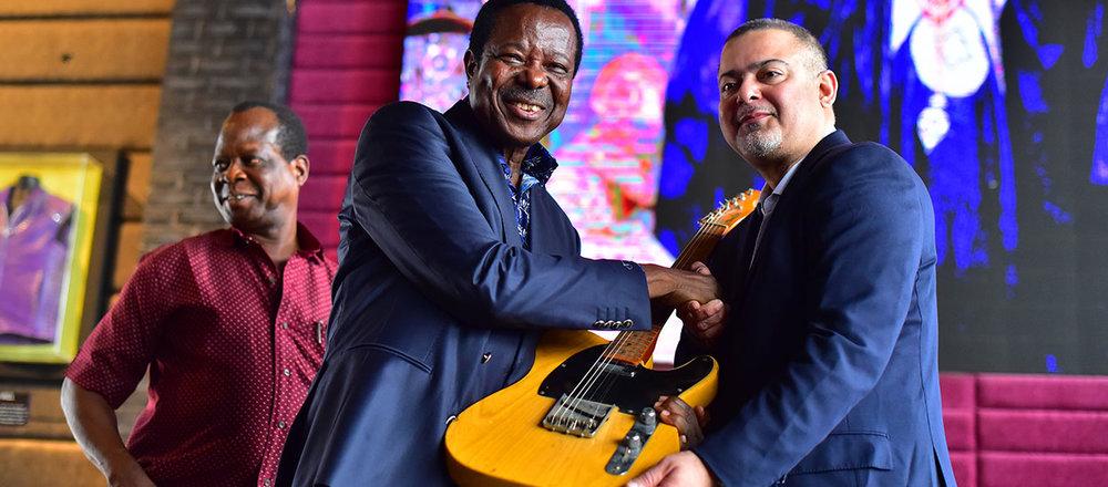King Sunny Ade presenting his KSA Vintage Fender Guitar to HARD ROCK CAFE LAGOS