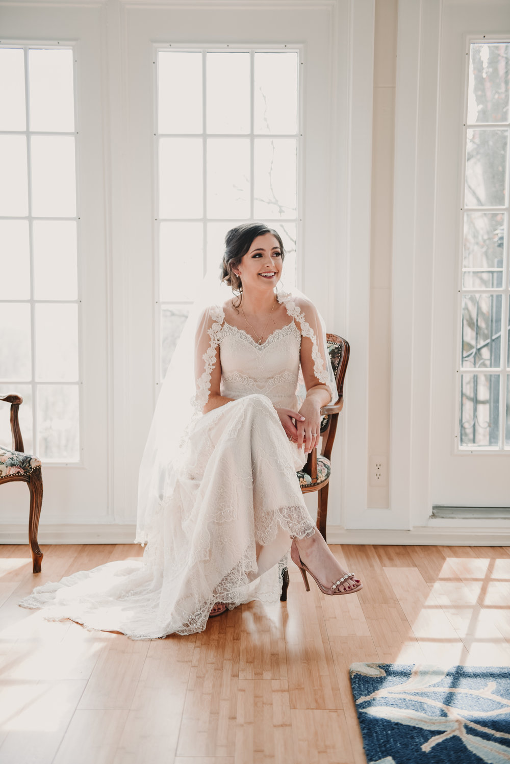 Bride sitting in a chair getting ready for her wedding
