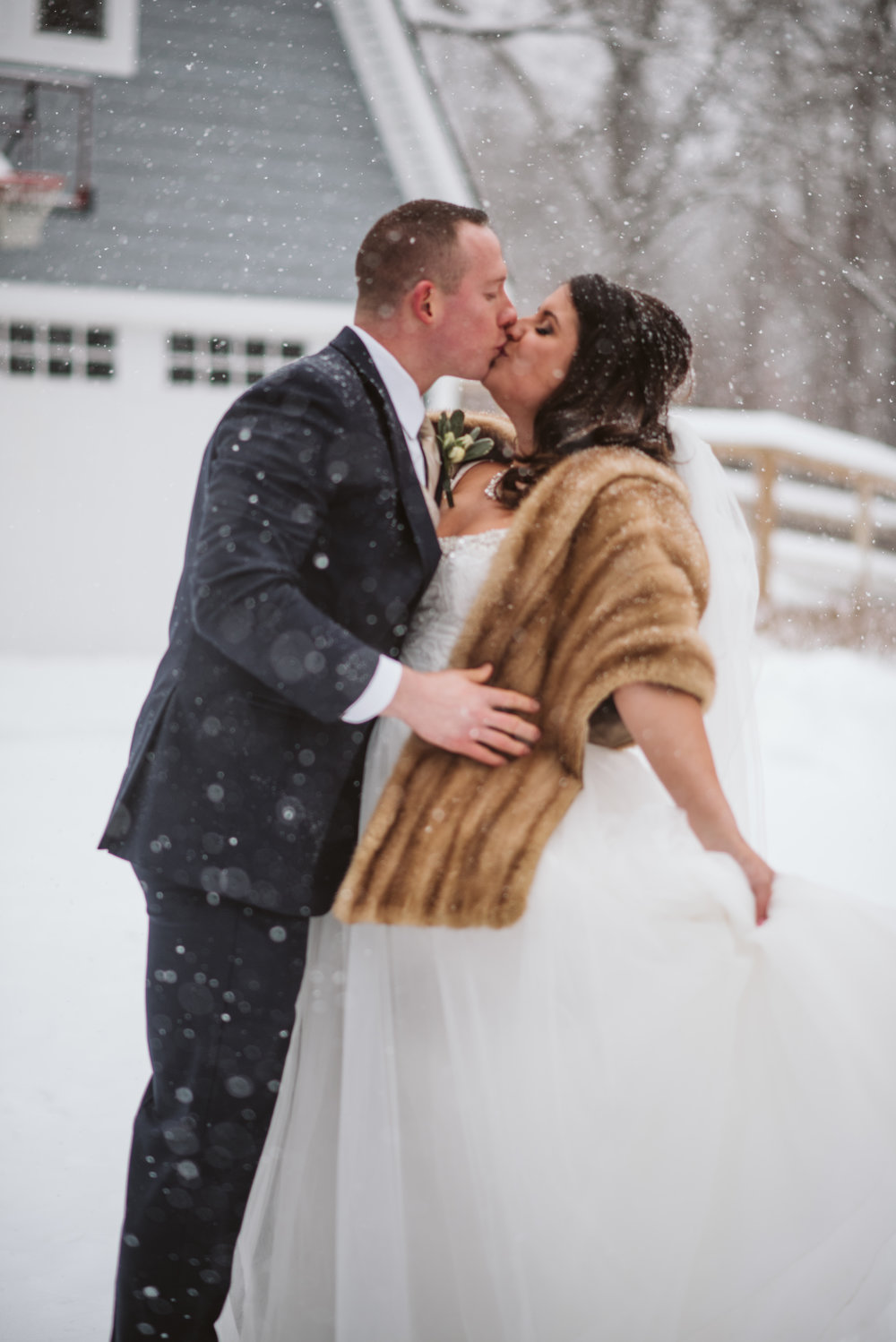 Bride and groom dancing in the snow