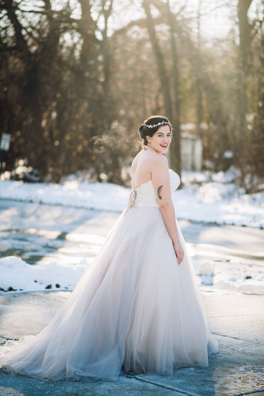 bride standing outside in the snow