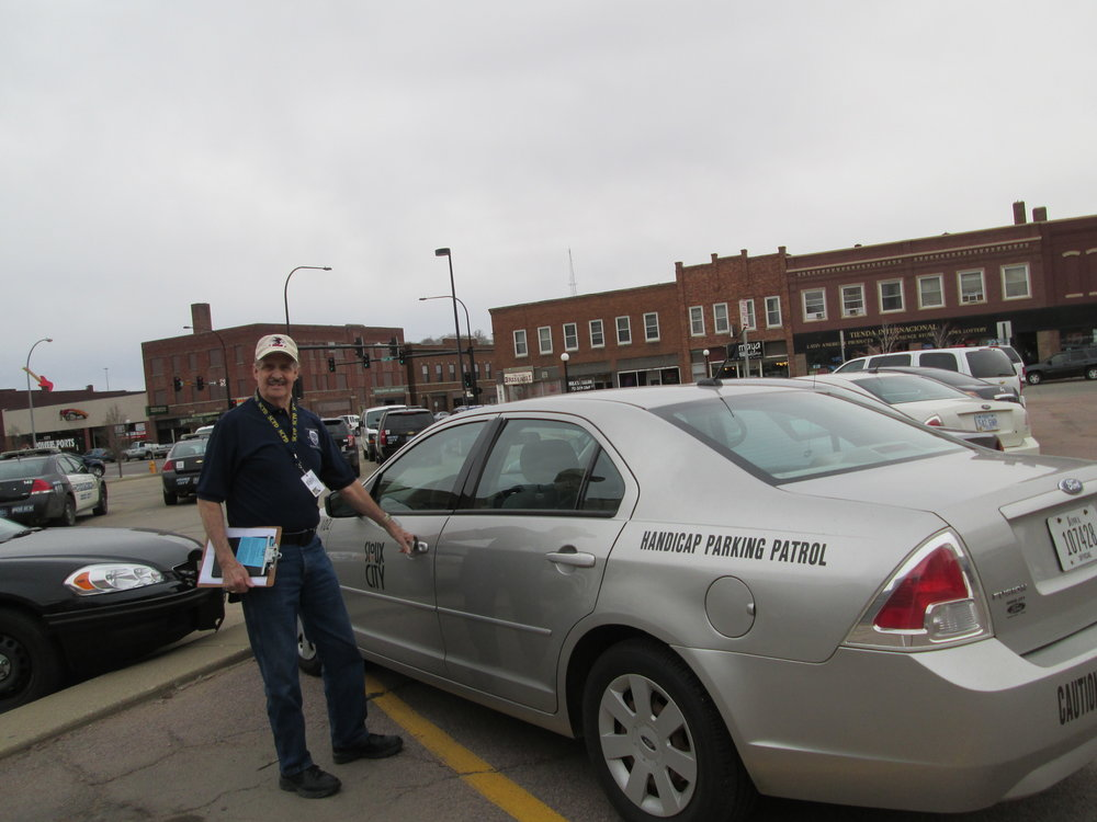 Ron, a Volunteer In Police Service, helping out with Handicap Parking Patrol