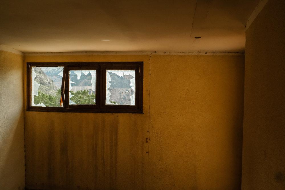 Vacant broken room window.