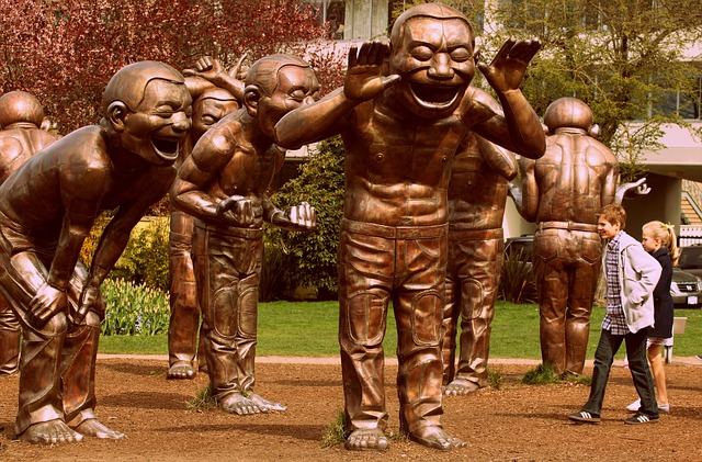 Courtesy Pixabay:  A-Maze-Zing Laughter  figures. Each face happens to be a self-portrait of the artist  Yue Minjun . Work installed 2009, Vancouver BC.