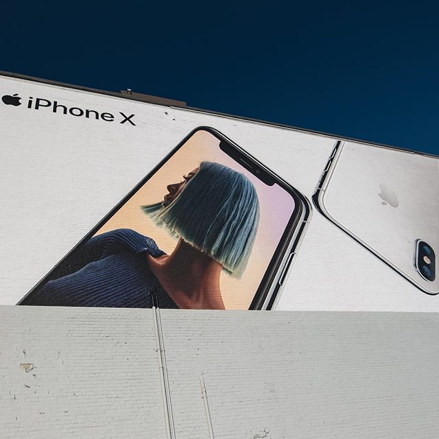iPhone X mural painted Toronto @ King and Spadina 30'x70'. #handpaintedsigns #upholdingthecraft #mural #iphonex  #bluehair
