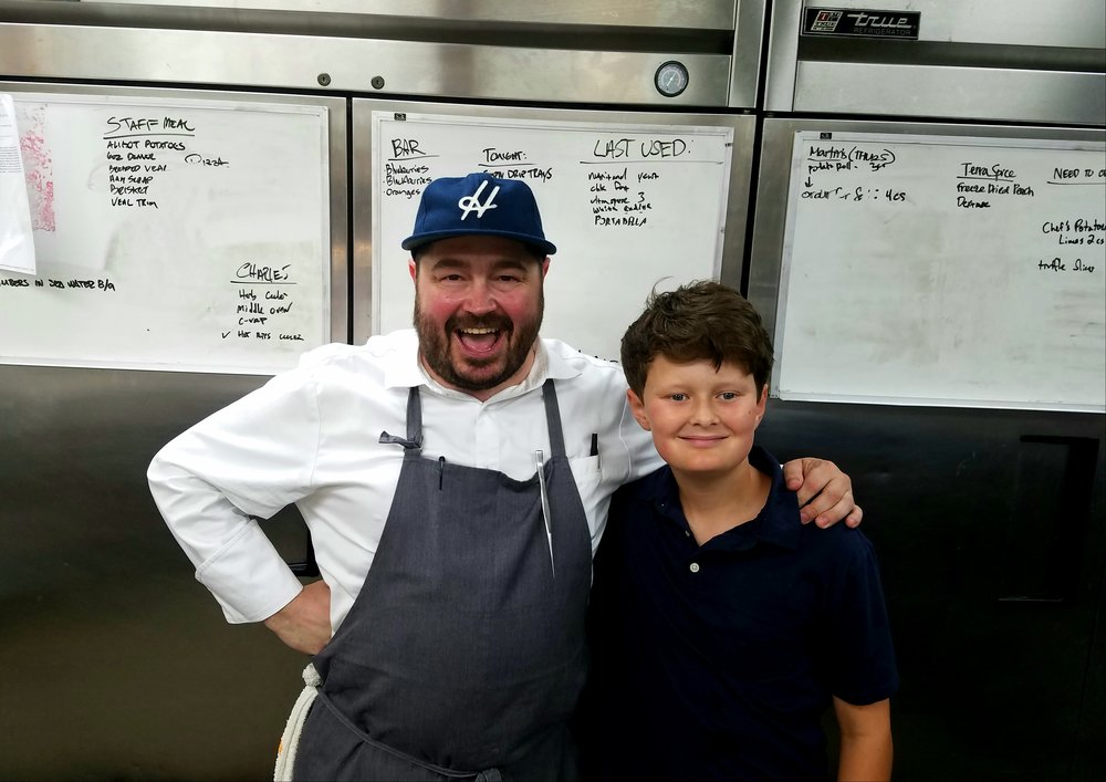 Dylan with Chef Sean Brock at the opening of McCrady's Tavern