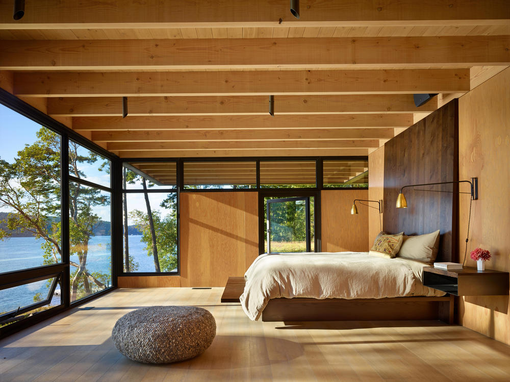 The master bedroom of Pole Pass lodge, in the San Juan Islands, Washington State, designed by Seattle-based Olson Kundig Architects