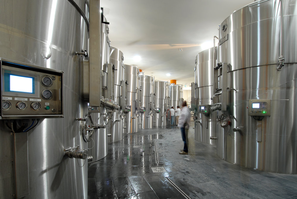 The tanks utilize naturally produced CO2 to gently mix grapes during fermentation