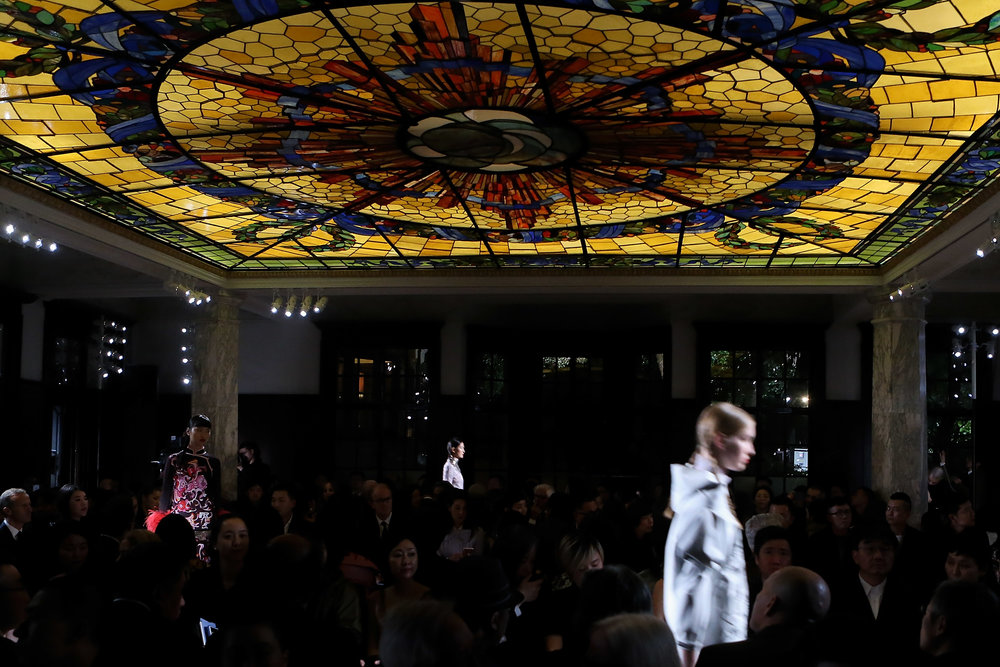 Prada Resort 2018 fashion show held under the restored stained-glass ceiling of the ballroom