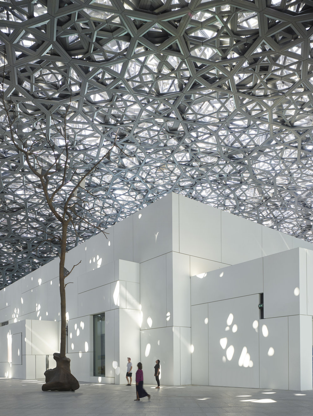 A 'rain of light', filtered through eight layers of geometric perforations in the dome